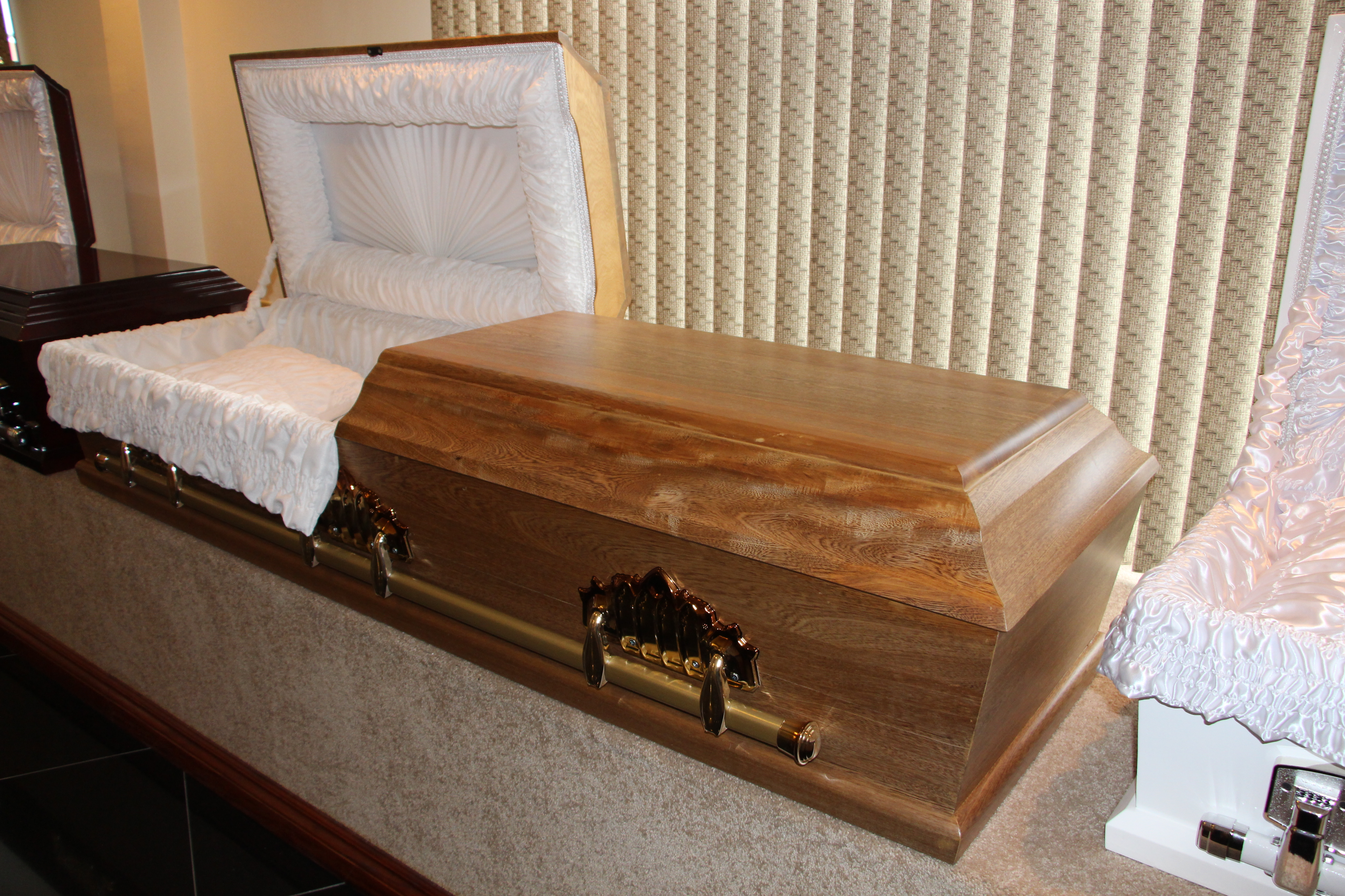 The Exterior Is Finished In Same Ornate Handles And Accessories As Standard Round Top Casket
